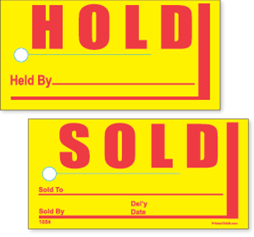 Yellow Hold and Sold pricing tags